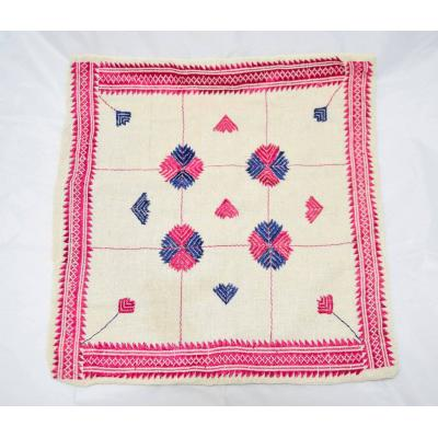 white and pink embroidered cushion cover
